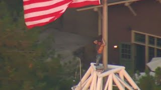 Man stood on top of tall tower at Knott's Berry Farm for hour before coming down safely