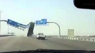 Dump Truck takes down Highway Sign