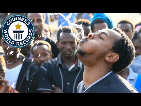 Longest time to spray water from the mouth - Guinness World Records