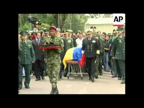 WRAP Reax to death of FARC No. 2, funeral of soldier, Venezuelan consulate
