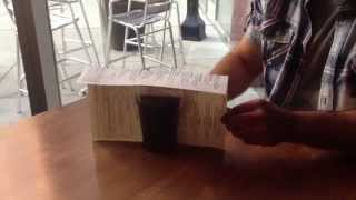 Magician cut a drink in half! This is crazy!