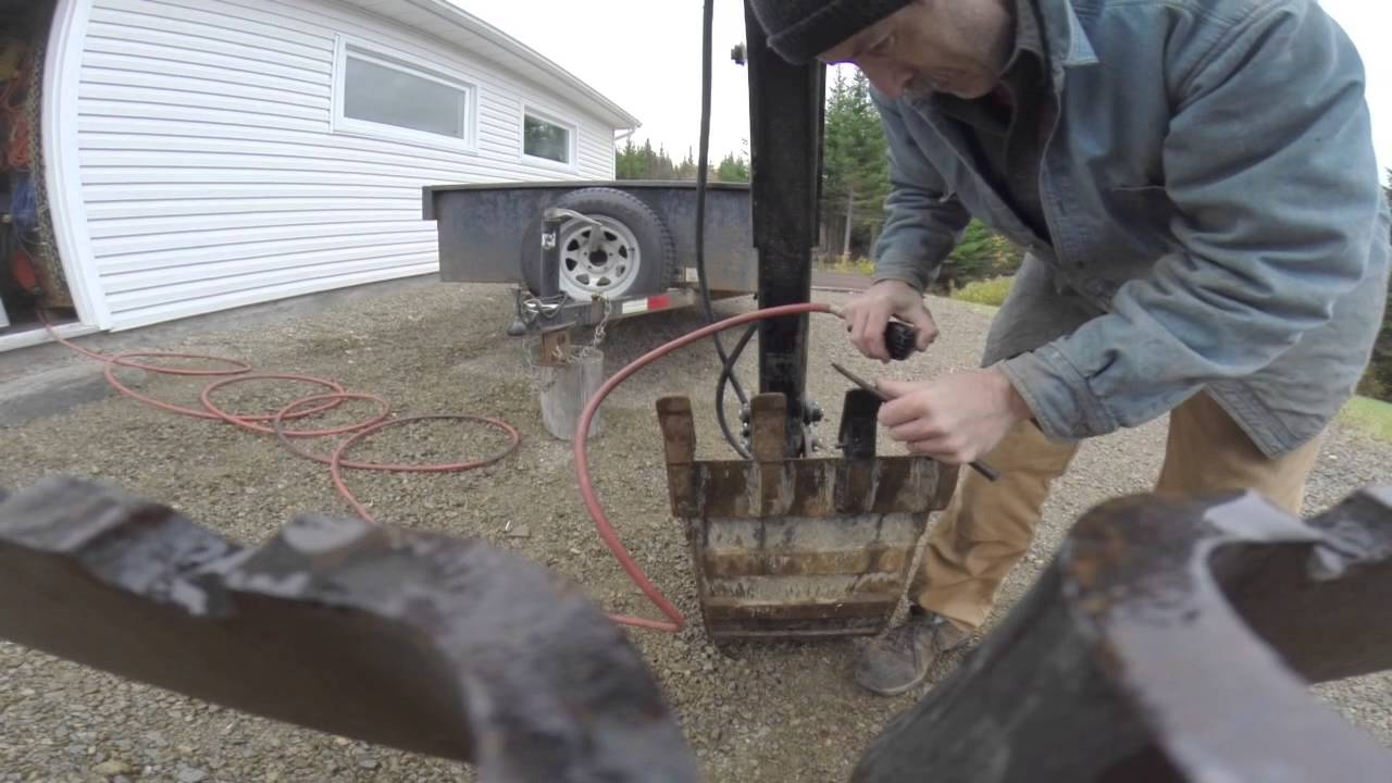 Replacing pins on excavator bucket