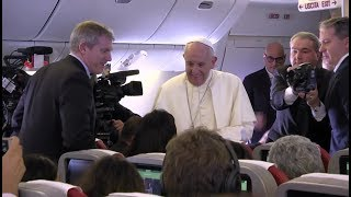 Inside papal plane: Pope Francis presents journalists with photo about nuclear war