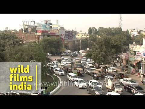 Traffic moves along a busy road in Faridabad