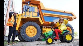 Senya Repairing a broken BIG tractor.