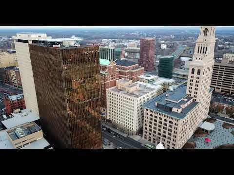 Hartford Connecticut downtown skyscrapers - continuous aerial 4K drone panorama footage using Litchi