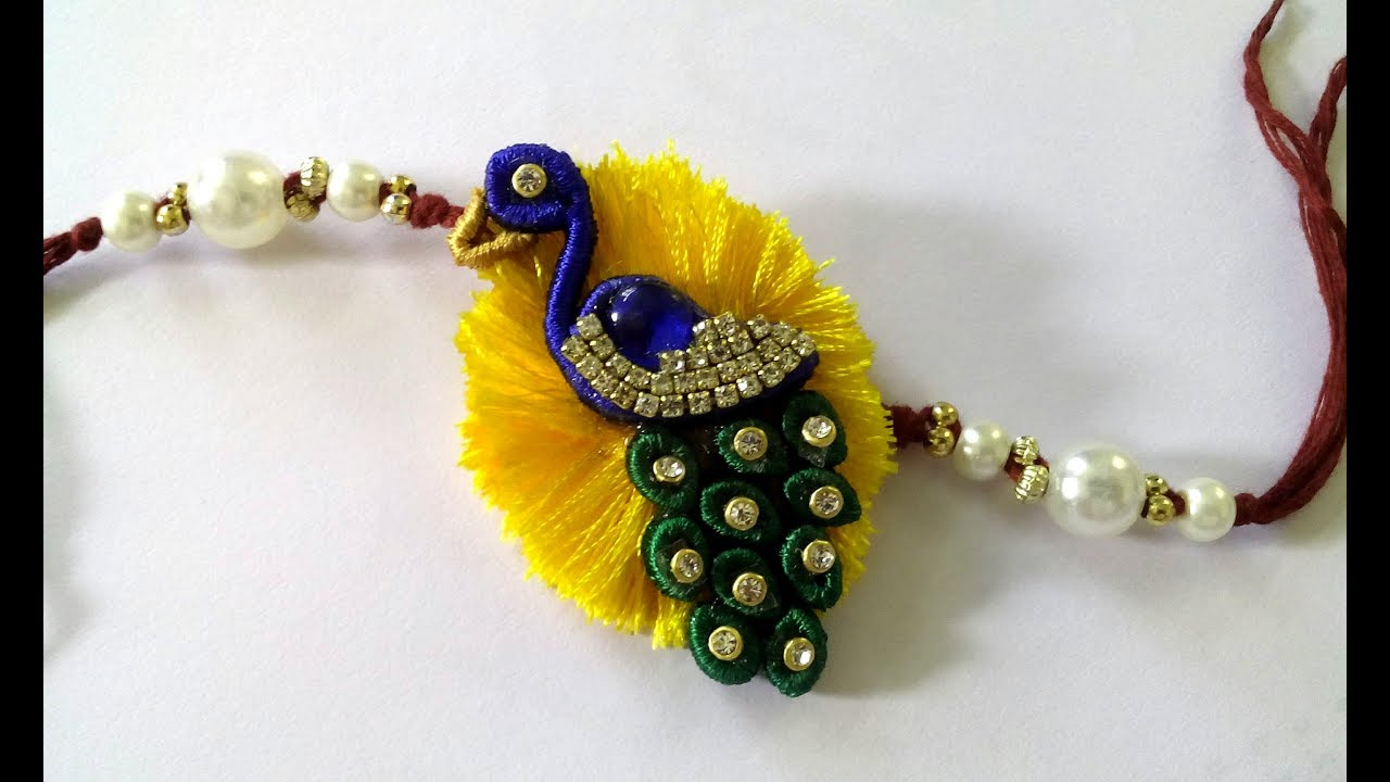 How To Make Rakhi With Silk Thread Peacock Rakhi Youtube
