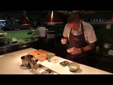 Clift prepares a dish with razor clams at Tippling Club in Singapore