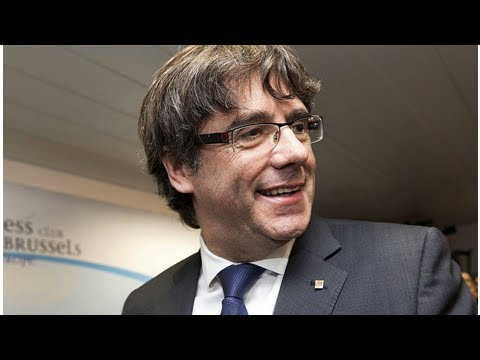 Catalan ex-president turns himself in to belgian police
