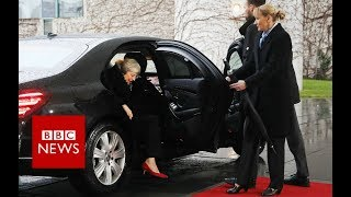 May I get out? PM's car door gets stuck - BBC News