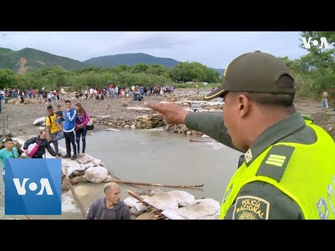 Colombia Police Block Venezuela Immigrants