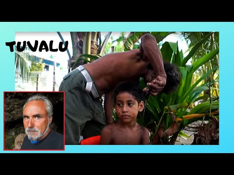 TUVALU, grandfather gives a haircut to his grandchild in FUN