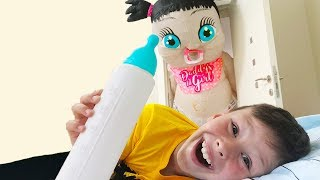 Ali and Adriana pretend play hide and seek with giant baby doll fun video for children