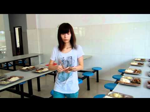 A Beautiful Chinese Girl Sets Chopsticks at the Kitchen at Jiande Yucai