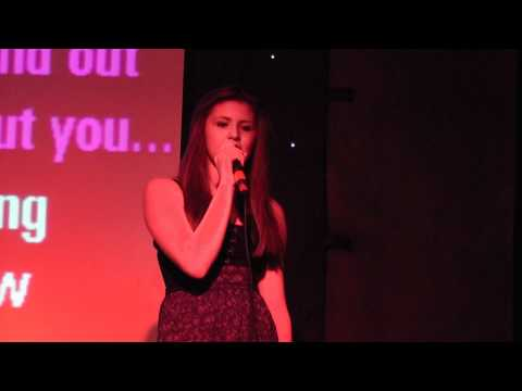 Laurie singing  at Oddies karaoke competition
