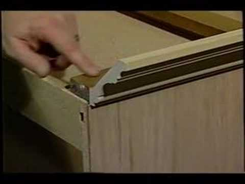 Cabinet crown molding youtube for Attaching crown molding to kitchen cabinets