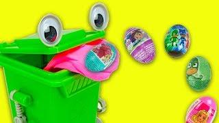 Мультик з зеленим контейнером, фантики в сюрпризи та іграшки