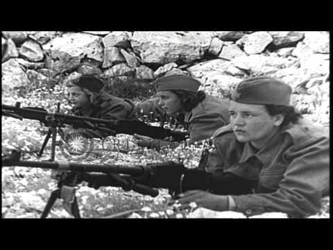 Yugoslav women partisans march in Yugoslavia during World War II. HD Stock Footage