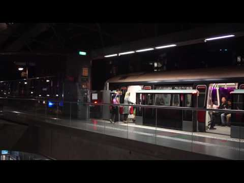 Singapore, train arriving and departing @ Expo MRT station