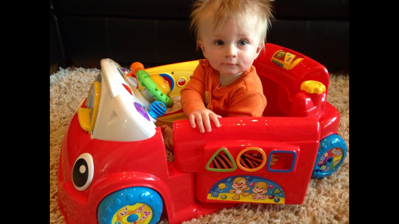 My 8 Month Old Playing In The Fisher Price Crawl Around Car