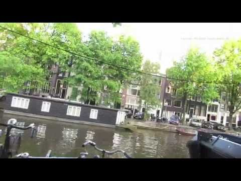 Walk past the Amsterdam Coffee Shops and along the Singel Canal in Holland