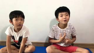 Giggly Brothers try meditation. Saliva all over his own face. Funny video of kids!