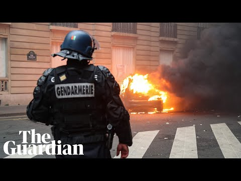 Riot police use teargas and water cannon in clashes with gilets jaunes in Paris