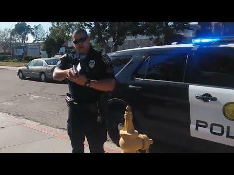 San Diego College Cop Points Gun at Photographer