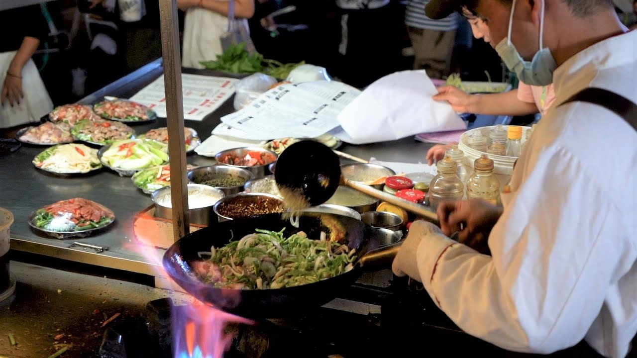 Chinese Street Food -Night market egg fried rice fried noodles, egg and vegetable pancakes
