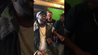 R. Kelly having a friendly sing-off with Slique Jay Adams