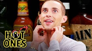 Adam Rippon Competes in the Olympics of Eating Spicy Wings   Hot Ones by : First We Feast