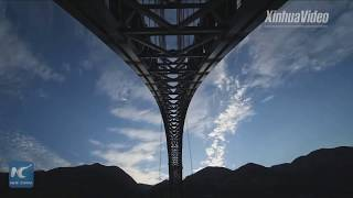 China builds world's longest-spanning railway arch bridge