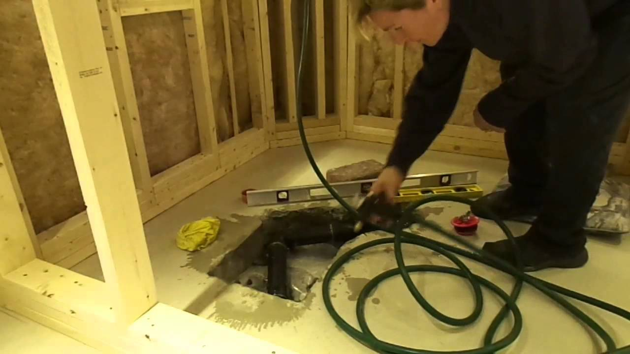 How to install a shower drain in a cement floor - YouTube