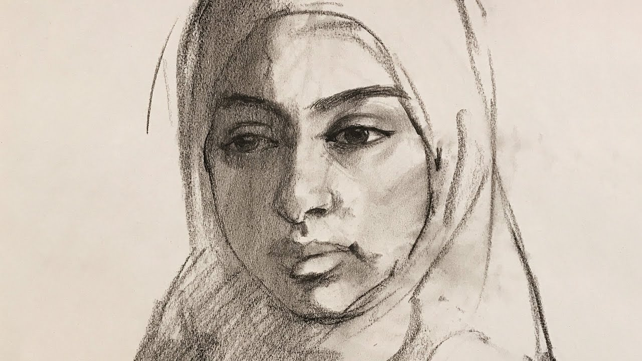 Portrait drawing with compressed charcoal and charcoal pencil