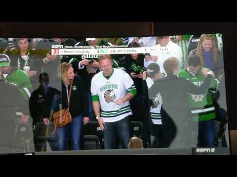 North Dakota hockey player hits Boston player through glass