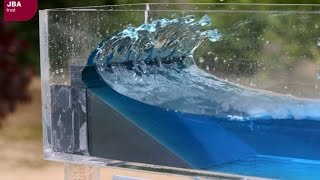 Wave tank demonstration showing the impact of coastal defences on flood risk