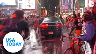 Car plows through group of protesters in Time Square | USA TODAY