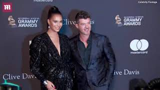 April Love Geary and Robin Thicke appear at the Pre-Grammy gala