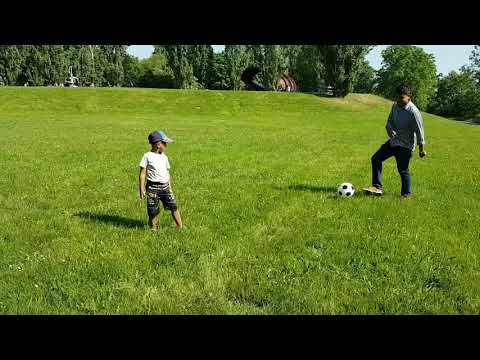 Playing football during my family picnic in Vienna near Danube River.