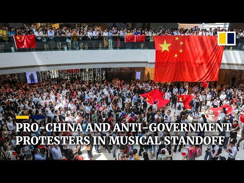 Pro-China and anti-government protesters in musical standoff