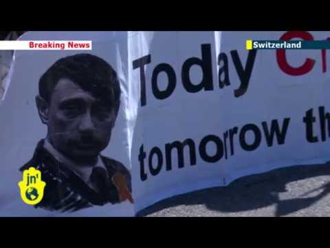 Ukraine Crisis: Anti-Putin demonstrators hold protest amid international talks in Geneva