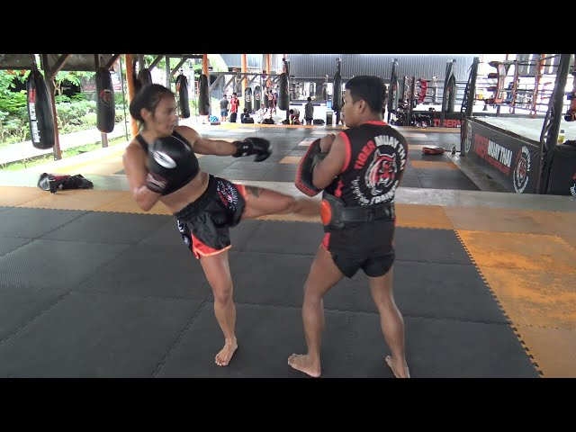 Dilshoda Umarova hitting pads with Kru Nin