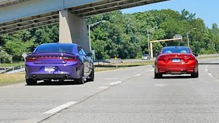 Dodge Charger Hellcat vs BMW M4 rolling drag race