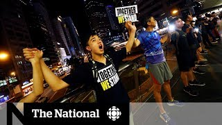 Hong Kong protesters form human chain in call for democracy
