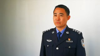 Grassroots police officer honored as China's national role model worker