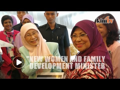 New Women and Family Development Minister Dr Wan Azizah clocks-in