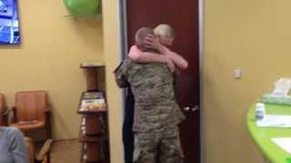 Sister can't stop hugging her brother after he surprises her by coming home from Afghanistan early