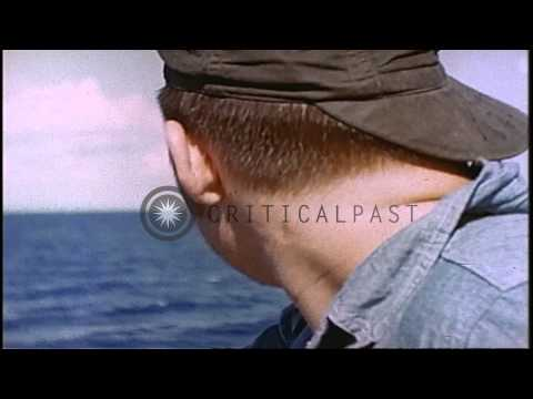 The crew aboard a US submarine in the Pacific Ocean during World War II. HD Stock Footage
