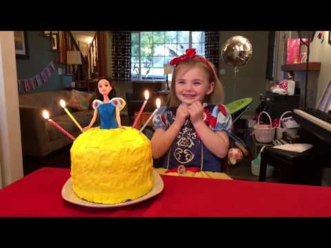 Violet blowing out 4 candles - March 2018