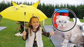 Öykü looking Cute Cat in the rain